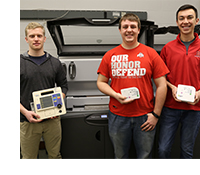 Peter Rogers assists students with 3-D printing