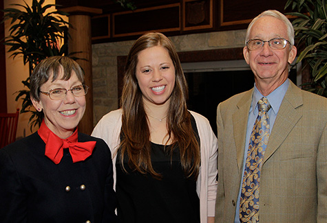 Carrie and Skip Gordon stand with a past scholarship recipient