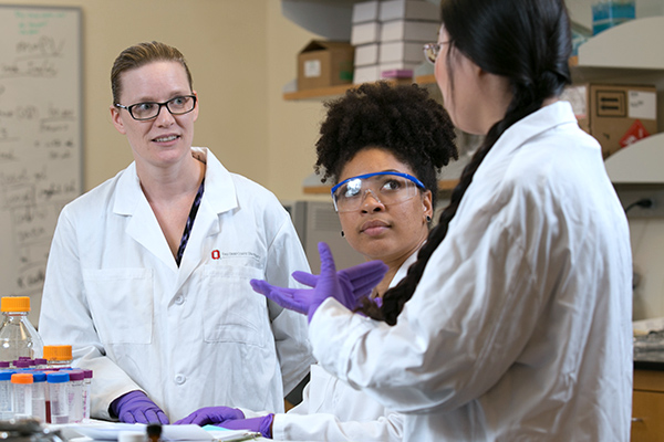 Dr. Jessica Winter working in lab with colleagues